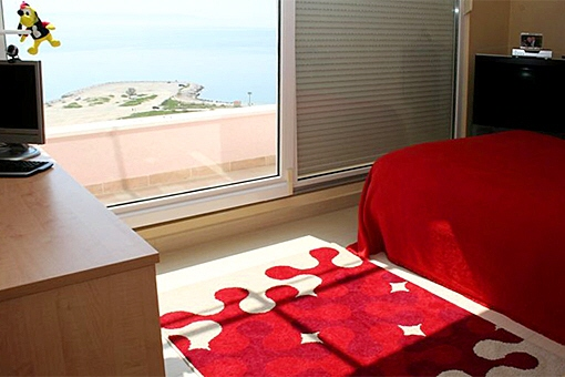 Bedroom with view towards the sea